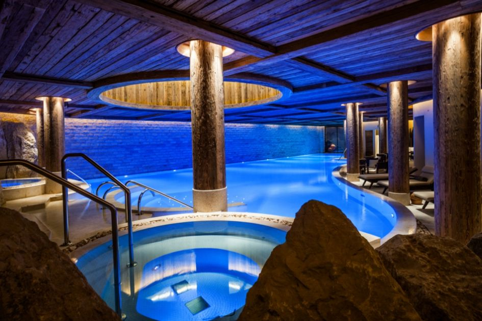 The vast indoor swimming pool with Jacuzzi baths at The Alpina