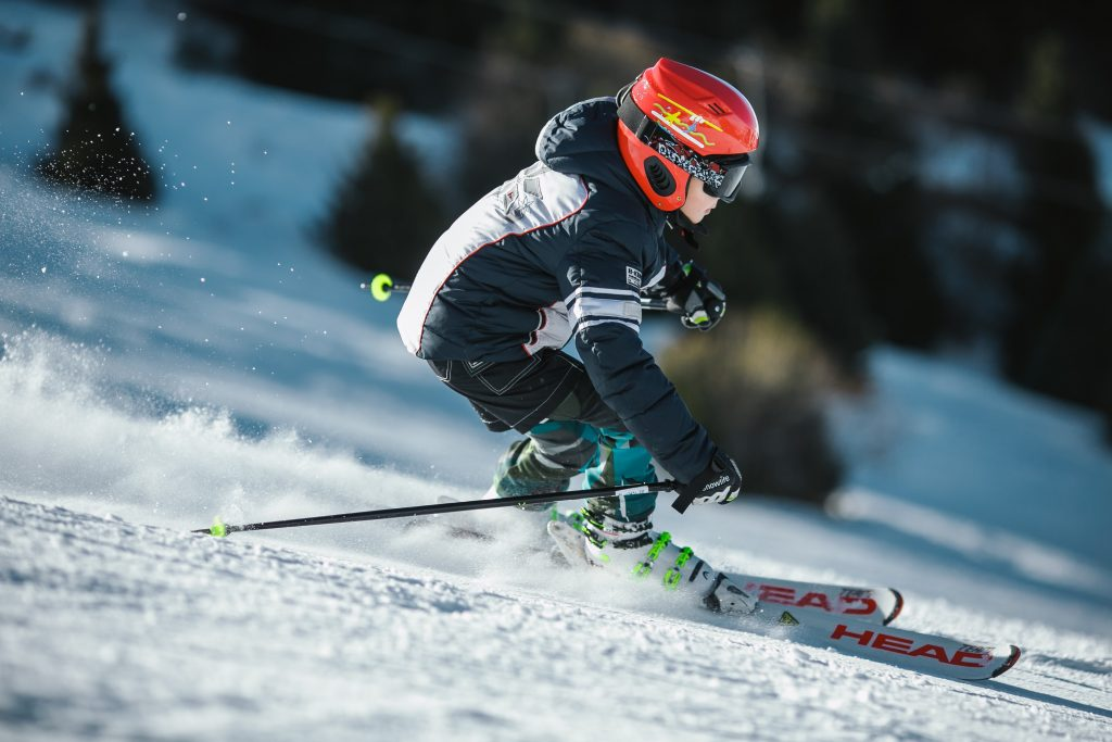 Child skiing in the sun