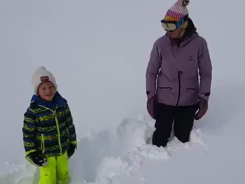 making snow angels, winter activities, winter fun, playing in the snow